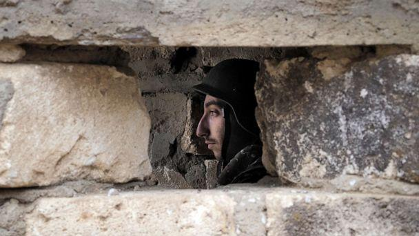 PHOTO: An Ethnic Armenian soldier is seen inside a dugout at a fighting position on the front line, during a military conflict against Azerbaijan's armed forces in the separatist region of Nagorno-Karabakh, Oct. 21, 2020. (AP)