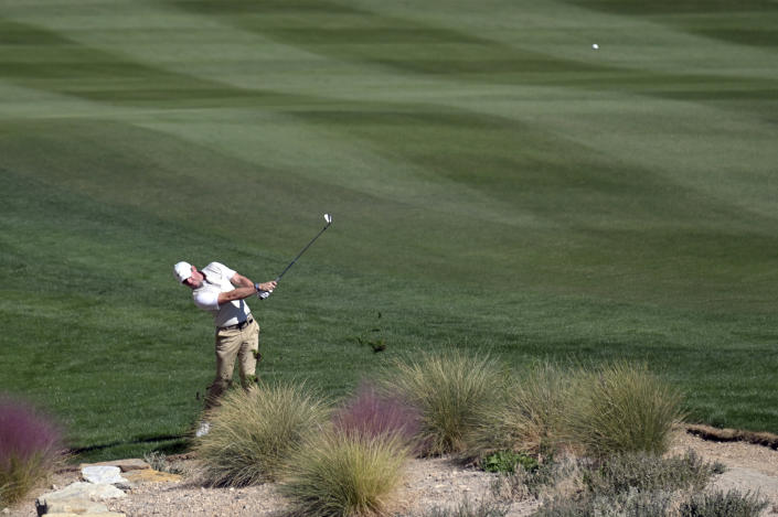 Rory McIlroy, of Northern Ireland, hits on the 17th hole during first round of the CJ Cup golf tournament Thursday, Oct. 14, 2021, in Las Vegas. (AP Photo/David Becker)