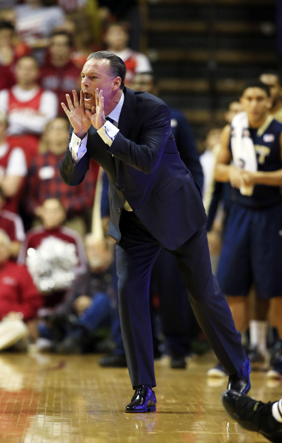 Pittsburgh head coach Jamie Dixon yells instructions during the first half of an NCAA college basketball game against Indiana, Tuesday, Dec. 2, 2014, in Bloomington, Ind. (AP Photo/Darron Cummings)