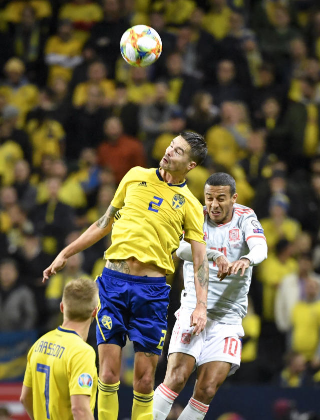Sweden's Mikael Lustig, left, and Spain's Thiago Alcantara during their Euro 2020 Group F qualification soccer match between Sweden and Spain at Friends Arena in Solna, Stockholm, Sweden, on Tuesday Oct. 15, 2019.(Anders Wiklund / TT via AP)