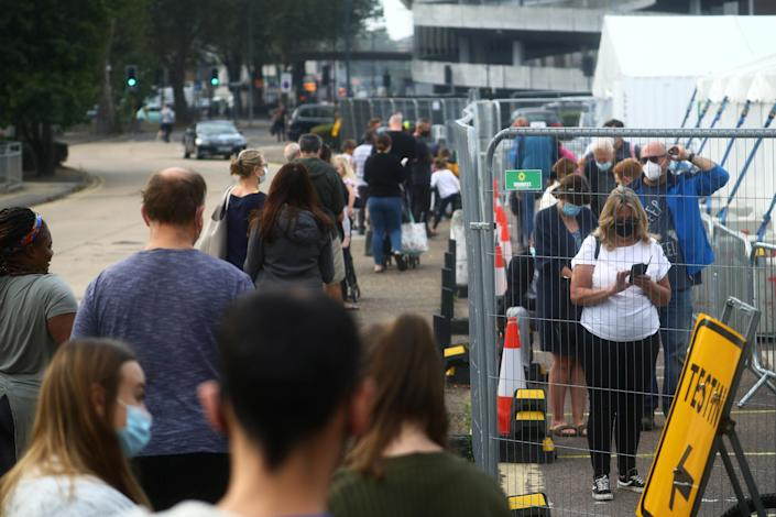 People queue at a coronavirus test centre in Southend-on-Sea, Essex, on Wednesday following an outbreak of COVID-19. (Reuters)