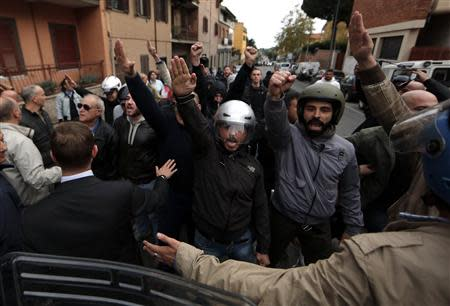 Supporters of Nazi war criminal Erich Priebke shout slogans after the hearse carrying his coffin arrived in Albano Laziale near Rome October 15, 2013. REUTERS/Yara Nardi