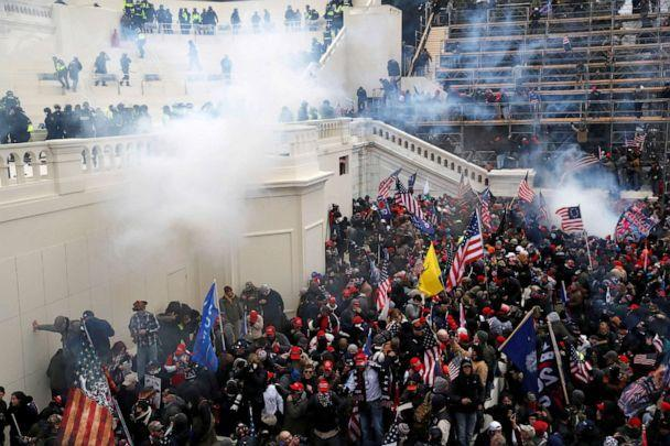 PHOTO: Police release tear gas into a crowd of U.S. President Donald Trump's supporters who are protesting the certification of the 2020 presidential election results by Congress at the U.S. Capitol Building in Washington, D.C., on Jan. 6, 2021. (Shannon Stapleton/Reuters)