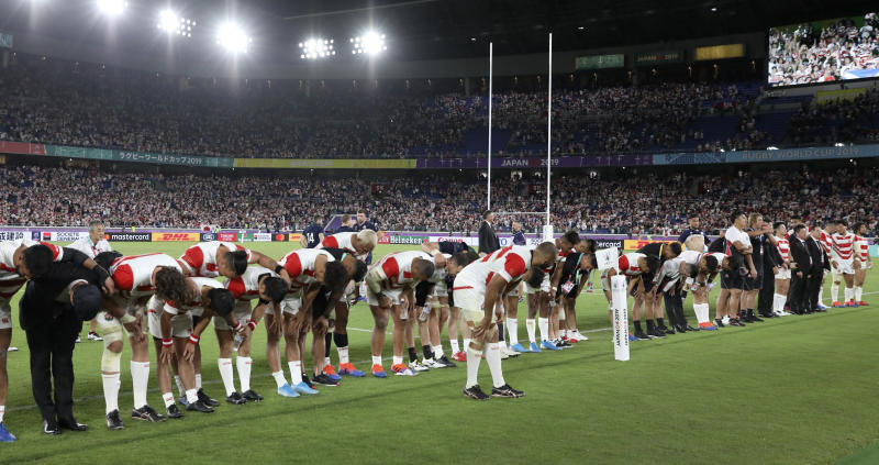 Japan players bow to the crowd as they celebrate after defeating Scotland 28-21 in their Rugby World Cup Pool A game at International Stadium in Yokohama, Japan, Sunday, Oct. 13, 2019. (AP Photo/Christophe Ena)