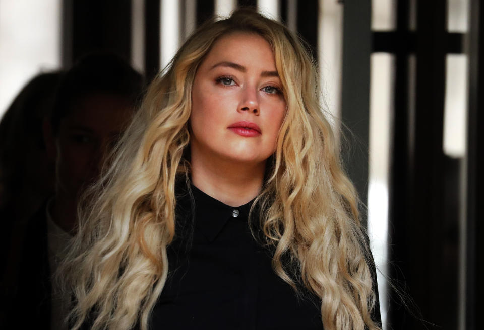 US Actress Amber Heard, former wife of actor Johnny Depp, arrives at the High Court in London, Tuesday, July 28, 2020. Hollywood actor Johnny Depp is suing News Group Newspapers over a story about his former wife Amber Heard, published in The Sun in 2018 which branded him a 'wife beater', a claim he denies. (AP Photo/Frank Augstein)
