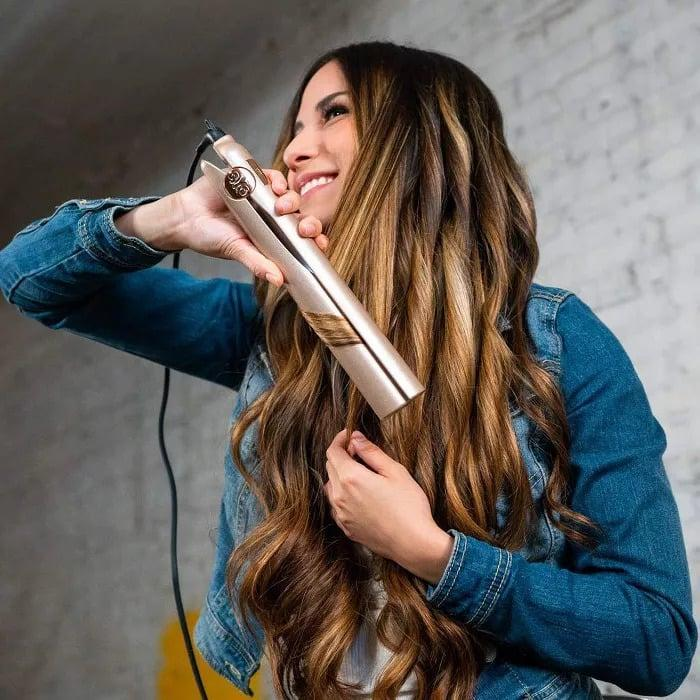 <p>The <span>Tyme Style Iron Pro 2-in-1 Hair Curler and Straightener</span> ($179, originally $240) has five adjustable heat settings and titanium plates for versatile yet smooth styling. You can curl and straighten with ease with this one tool. </p>