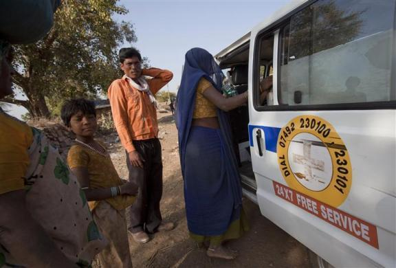 Anguri (R), a 26-year-old pregnant woman in labour, climbs into a waiting maternity ambulance as her relatives stand near her in a rural area near the remote village of Chharchh, in the central Indian state of Madhya Pradesh, February 24, 2012. The United Nations' International Women's Day was celebrated on March 8, 2012.