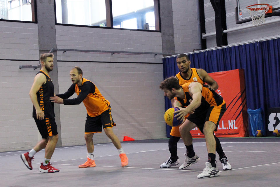 Julian Jaring, right, protects the ball from Dimeo van der Horst, backgrouund right, as Aron Roije defends Deividas Kumelis, left during a Netherlands 3x3 basketball team practice at a court in Amsterdam, Tuesday June 22, 2021 in preparation for the Tokyo Olympics. Three-on-three basketball debuts as an Olympic sport in Tokyo and presents traditionally overlooked basketball countries with opportunities for medals. (AP Photo/Kenneth Maguire)