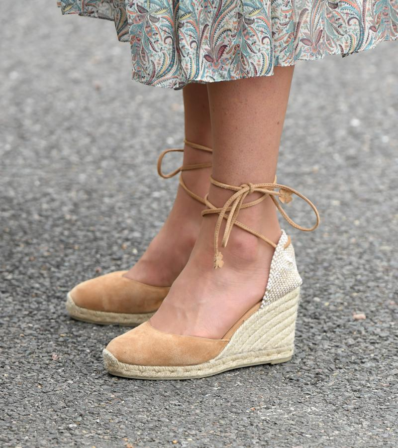 KINGSTON, ENGLAND - JUNE 25: Catherine, Duchess of Cambridge, shoe detail, joins a photography workshop for Action for Children, run by the Royal Photographic Society at Warren Park Children's Centre on June 25, 2019 in Kingston, England.HRH has today become Patron of The Royal Photographic Society. (Photo by Karwai Tang/WireImage)