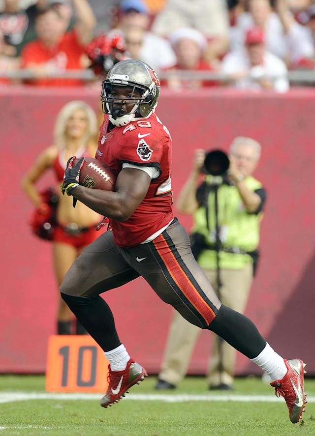 Tampa Bay Buccaneers running back Bobby Rainey (43) scores on a 43-yard touchdown run against the Atlanta Falcons during the second quarter of an NFL football game on Sunday, Nov. 17, 2013, in Tampa, Fla. (AP Photo/Brian Blanco)
