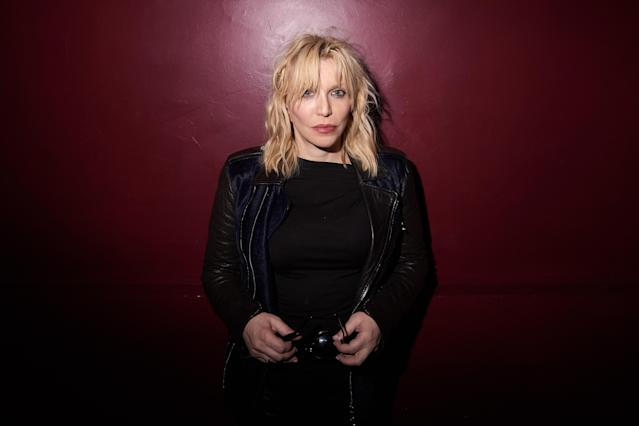 "Courtney Love says the ""universe always rips open on this day"" — the anniversary of Kurt Cobain's death. (Photo: Victor Boyko/Getty Images for Balmain at Paris Fashion Week 2018)"