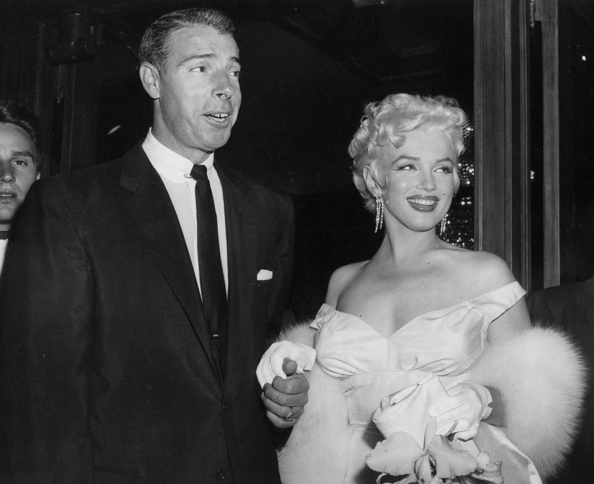 FILE - In this June 2, 1955 file photo, actress Marilyn Monroe, right, in a glamorous evening gown, with Joe DiMaggio, arrives at the theater. (AP Photo, File)