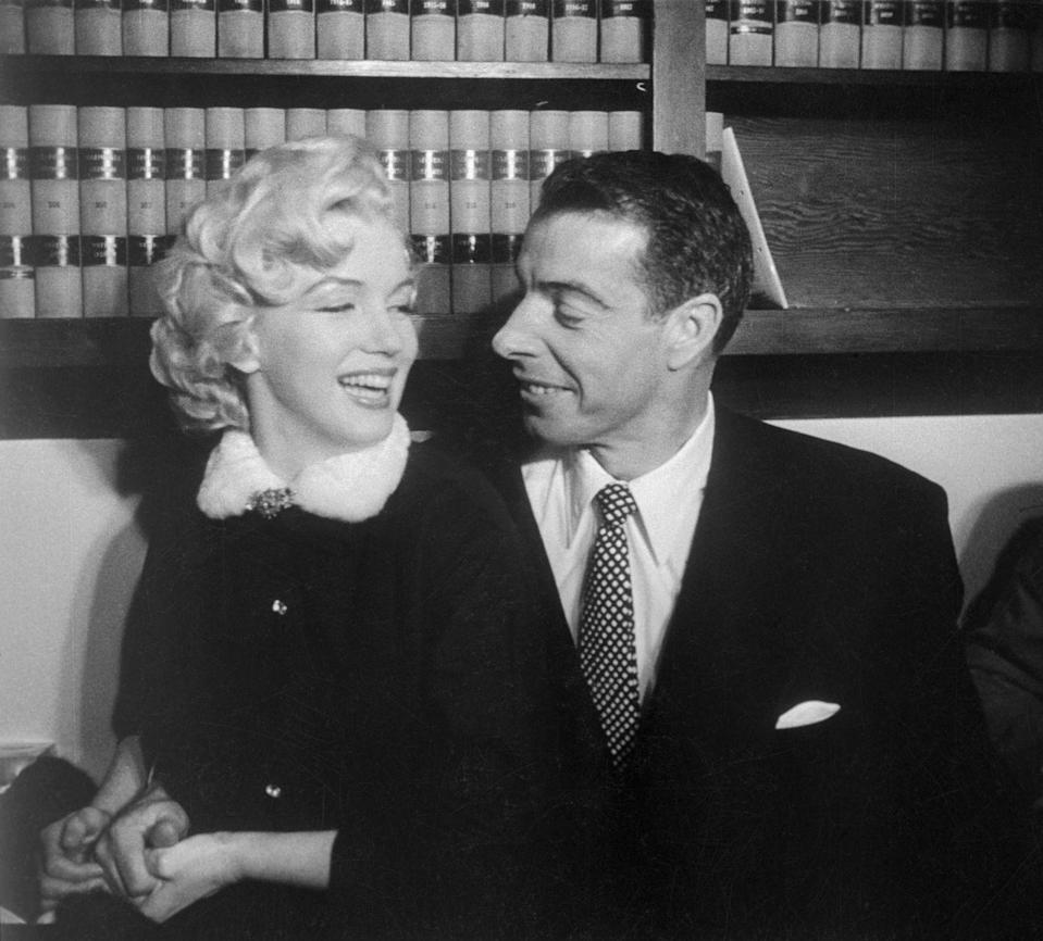 """<p>Marilyn Monroe and Joe DiMaggio were wed in a spontaneous civil ceremony at the San Francisco courthouse. DiMaggio gives the Hollywood starlet a look of love as the two say """"I do"""" in the low-key nuptials. </p>"""