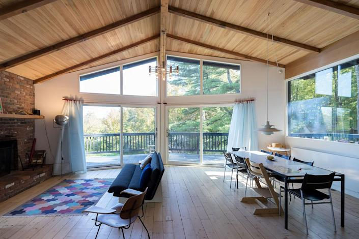 """<p>In 2018, the homeowners, a Dutch-Canadian family, enlisted the husband-and-wife duo behind Group AU to completely reimagine the three-bedroom home nestled within a highly wooded lot in the Berkshires. The black-painted board and batten facade, wood-paneled sloped ceilings, and open layout give the space an undeniable Scandinavian feel. Even the decor—colorful hairpin stools, Poul Henningsen pendants, and organic materials—are utterly Mid-Century Modern.</p> <p>More importantly, though, the chalet is totally secluded, offering a sense of privacy and quiet that anyone fleeing a major city may crave. That said, it's only five minutes from Lake Buel and the charming ski town, Great Barrington.</p> $450, Airbnb. <a href=""""https://www.airbnb.com/rooms/37690377?"""" rel=""""nofollow noopener"""" target=""""_blank"""" data-ylk=""""slk:Get it now!"""" class=""""link rapid-noclick-resp"""">Get it now!</a>"""