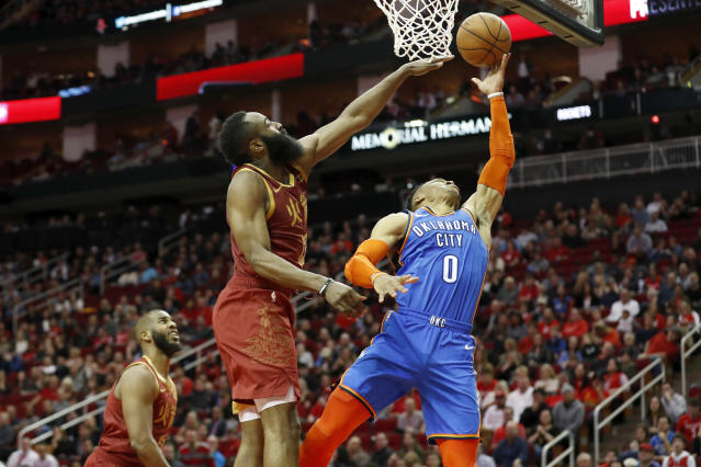 HOUSTON, TX - FEBRUARY 09: Russell Westbrook #0 of the Oklahoma City Thunder goes up for a shot defended by James Harden #13 of the Houston Rockets in the second half at Toyota Center on February 9, 2019 in Houston, Texas. (Photo by Tim Warner/Getty Images)