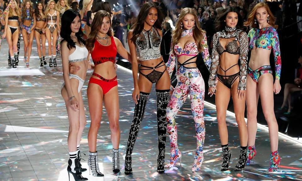 Victoria's Secret Angels pose on the runway during the brand's 2018 fashion show.