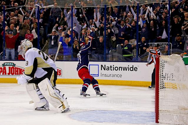COLUMBUS, OH - APRIL 23: Marc-Andre Fleury #29 of the Pittsburgh Penguins skates off the ice as Nick Foligno #71 of the Columbus Blue Jackets celebrates scoring the game winning goal during the overtime period in Game Four of the First Round of the 2014 NHL Stanley Cup Playoffs at Nationwide Arena on April 23, 2014 in Columbus, Ohio. Columbus defeated Pittsburgh 4-3 in overtime. (Photo by Kirk Irwin/Getty Images)