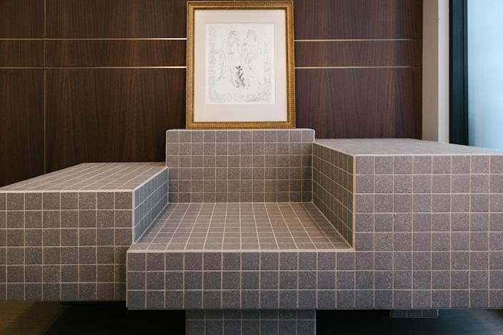The large tiled lounge seat in the entryway is by architect and designer Nima Abili.