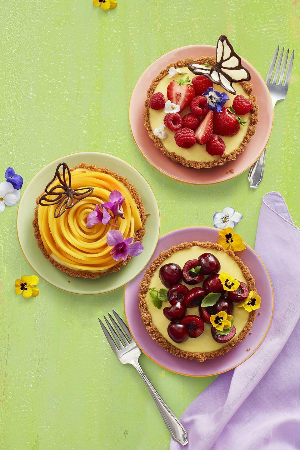"""<p>Hello, sweet spring mini desserts! These fruity lemon tarts are a great way to make a Mother's Day brunch spread Instagram-worthy. </p><p><a href=""""https://www.womansday.com/food-recipes/food-drinks/a19810477/no-bake-lemon-tarts-recipe/"""" rel=""""nofollow noopener"""" target=""""_blank"""" data-ylk=""""slk:Get the recipe for No-Bake Lemon Tarts."""" class=""""link rapid-noclick-resp""""><em>Get the recipe for No-Bake Lemon Tarts.</em></a> </p>"""