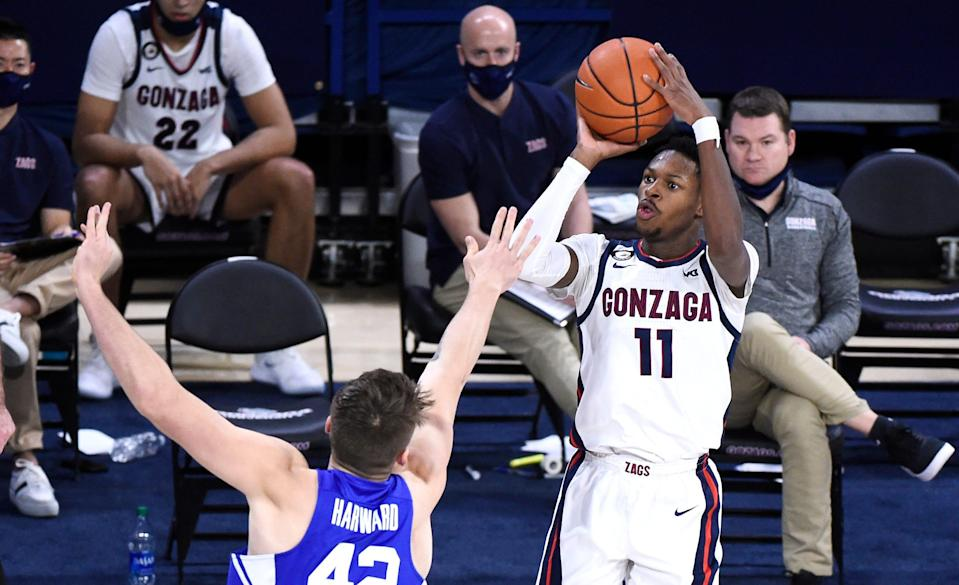 Gonzaga guard Joel Ayayi (11) puts up a shot over Brigham Young center Richard Harward in the second half of their game at McCarthey Athletic Center.