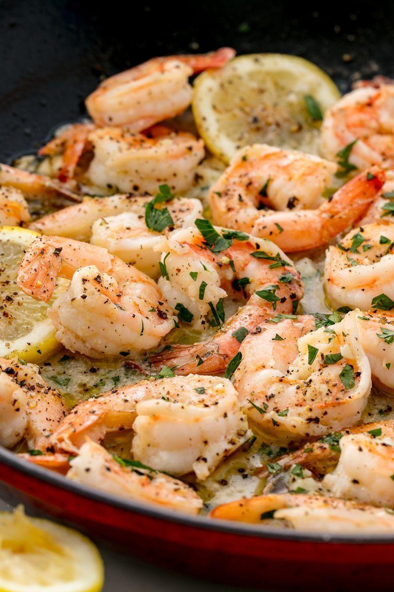 """<p>This garlic butter prawns recipe requires almost no planning—all you need to do is pick up prawns! Meaning, it's perfect for dinner TONIGHT. It sounds too good to be true, but it's not. The whole thing can be yours in 15 minutes or less. And it's absolutely delicious.</p><p>Get the <a href=""""https://www.delish.com/uk/cooking/recipes/a29664285/easy-lemon-garlic-shrimp-recipe/"""" rel=""""nofollow noopener"""" target=""""_blank"""" data-ylk=""""slk:Lemon Garlic Prawns"""" class=""""link rapid-noclick-resp"""">Lemon Garlic Prawns</a> recipe. </p>"""