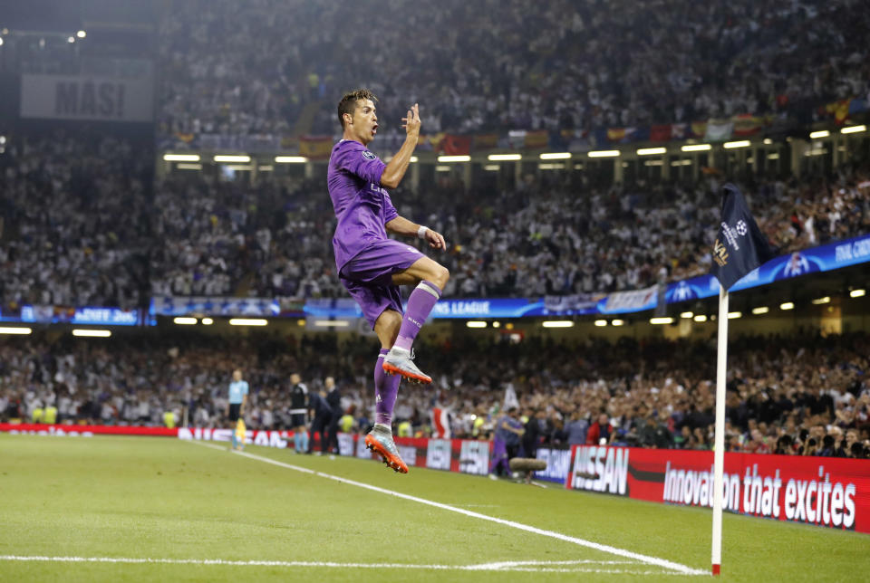 FILE - In this Saturday June 3, 2017 file photo Real Madrid's Cristiano Ronaldo celebrates after scoring the opening goal during the Champions League final soccer match between Juventus and Real Madrid at the Millennium stadium in Cardiff, Wales. Neither Lionel Messi nor Cristiano Ronaldo will be in the Champions League quarterfinals for the first time since 2005. The two greatest players of the current generation were both eliminated from the competition this week. Messi scored a goal but missed a penalty as Barcelona was eliminated by Paris Saint-Germain. Ronaldo and his Juventus teammates were ousted by Porto the night before. Ronaldo has won five Champions League titles in his career. Messi has won four. (AP Photo/Frank Augstein, File)