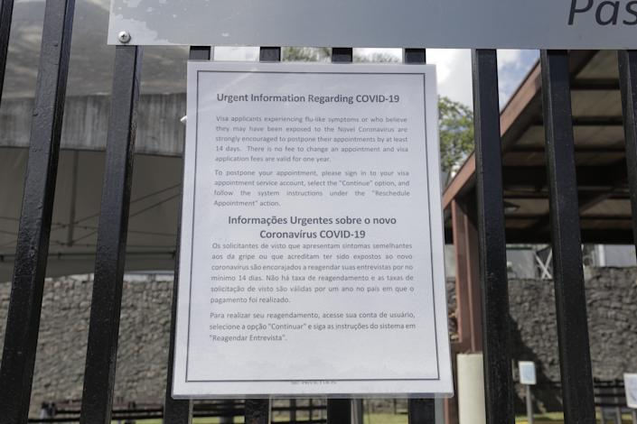 A sign at the gates of U.S consulate in Sao Paulo, Brazil on March 25, 2020 reads that the building is closed due to the coronavirus pandemic. All visa appointments were postponed and the United States Embassy in Brazil recommended their citizens to return to the U.S. (Rebeca Figueiredo Amorim/Getty Images)