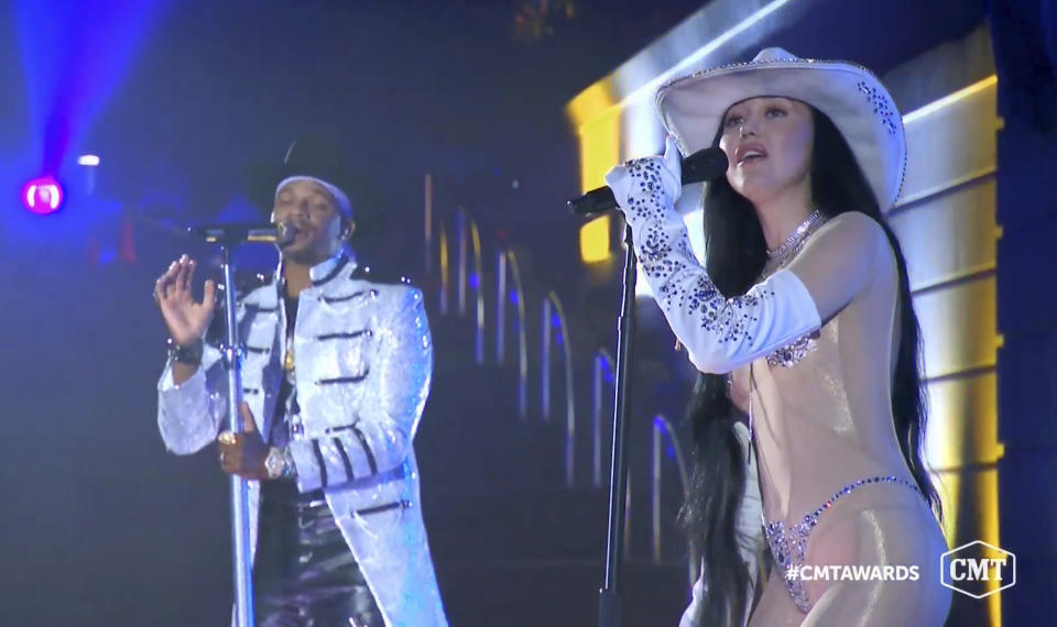 "In this video image provided by CMT, Jimmie Allen, left, and Noah Cyrus perform ""This Is Us"" during the Country Music Television awards airing on Wednesday, Oct. 21, 2020. (CMT via AP)"
