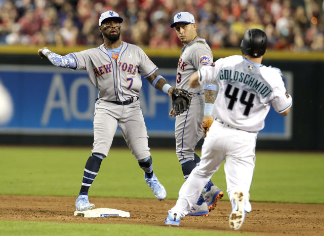 New York Mets shortstop Jose Reyes (7) turns the double play while avoiding Arizona Diamondbacks' Paul Goldschmidt (44) on a ball hit by Jake Lamb in the sixth inning during a baseball game, Sunday, June 17, 2018, in Phoenix. (AP Photo/Rick Scuteri)
