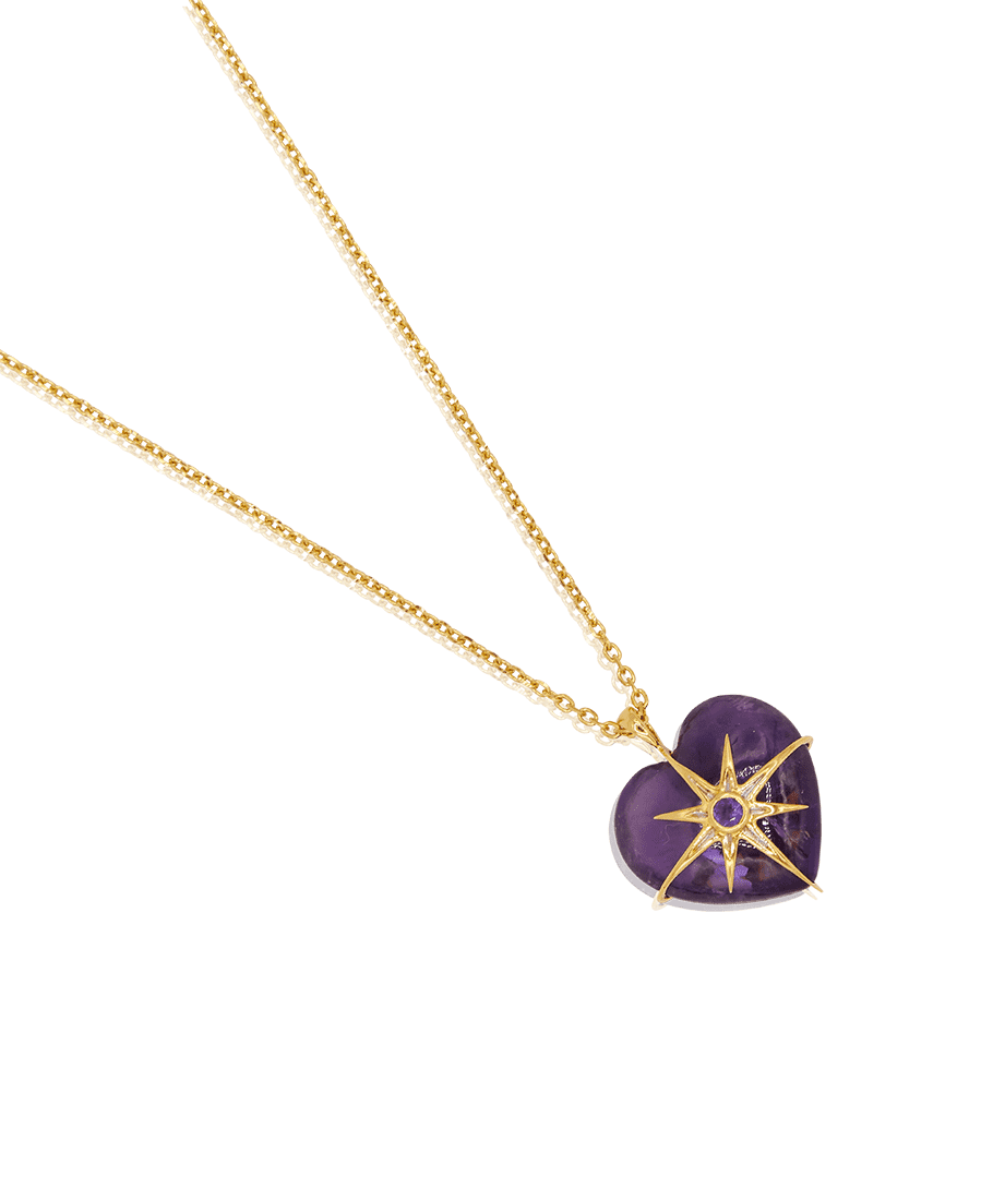 """<p><a class=""""link rapid-noclick-resp"""" href=""""https://theodorawarre.co.uk/amethyst-heart-star-pendant"""" rel=""""nofollow noopener"""" target=""""_blank"""" data-ylk=""""slk:SHOP NOW"""">SHOP NOW</a></p><p> Romance lovers will adore this hand-carved amethyst pendant, embellished with a shimmering gold star. </p><p>Amethyst pendant and chain, £340, <a href=""""https://theodorawarre.co.uk/"""" rel=""""nofollow noopener"""" target=""""_blank"""" data-ylk=""""slk:Theodora Warre"""" class=""""link rapid-noclick-resp"""">Theodora Warre</a>.</p>"""