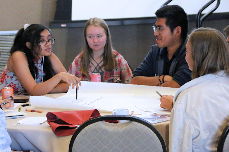 "Aditi Narayana, left, discusses ideas for economic solutions to address climate change with Ryan Harrop, center, and Brian Mecinas, right, during the youth forum at the conference ""Climate 2020: Seven Generations for Arizona"" at Northern Arizona University in Flagstaff on Saturday."