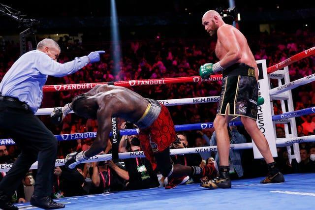 Tyson Fury knocks out Deontay Wilder to win in the 11th round of their trilogy fight