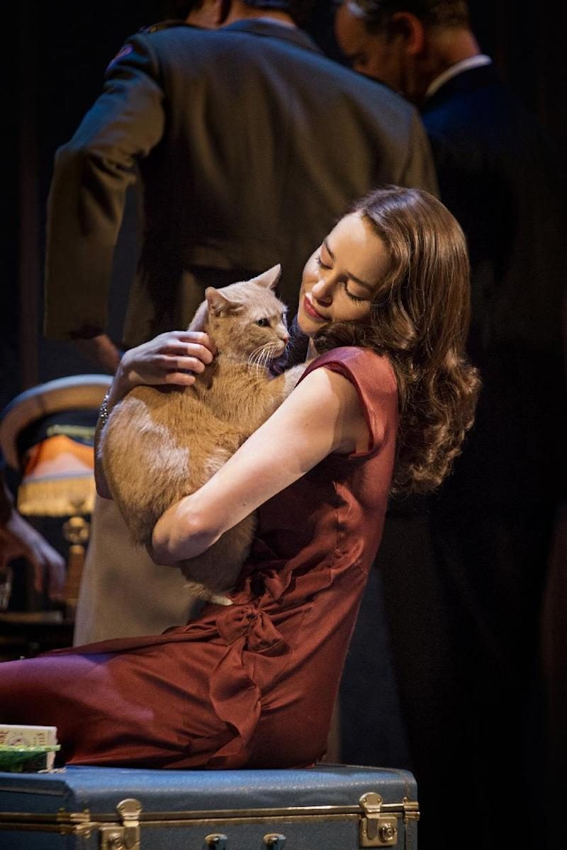 """This theater image released by The O+M Company shows Emilia Clarke in a scene from """"Breakfast at Tiffany's,"""" performing at the Cort Theatre in New York. (AP Photo/The O+M Company, Nathan Johnson Photography)"""