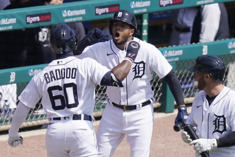 Detroit Tigers' Akil Baddoo (60) is greeted by Jeimer Candelario after hitting a solo home run during the third inning of a baseball game against the Cleveland Indians, Sunday, April 4, 2021, in Detroit. (AP Photo/Carlos Osorio)