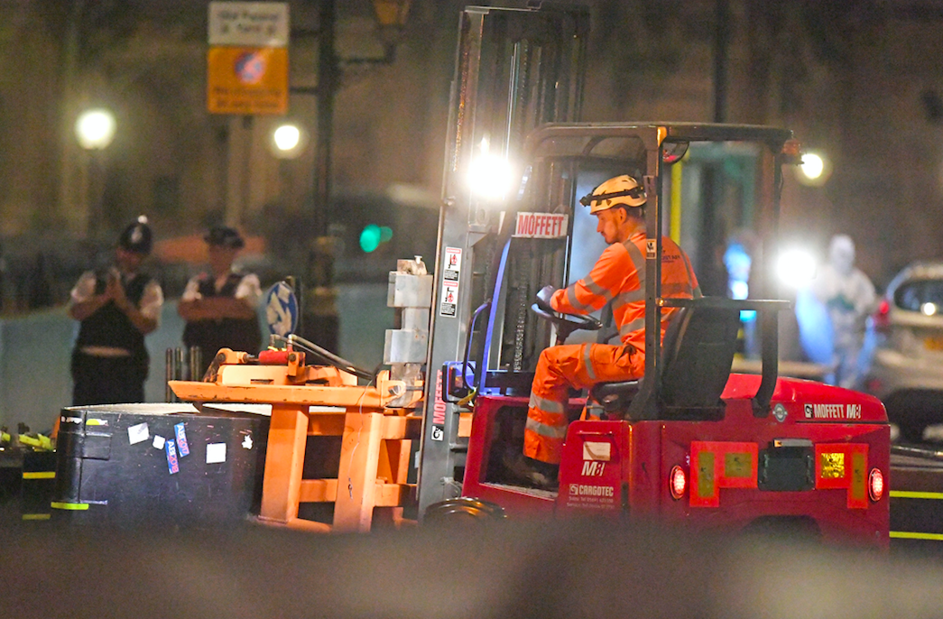 <em>A forklift truck removes the security barrier that the car crashed into (PA)</em>