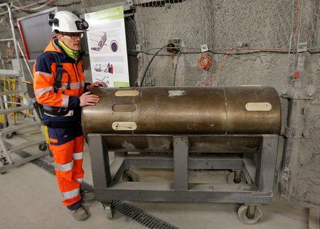 Mathieu Saint-Louis, spokesperson for the French National Radioactive Waste Management Agency ANDRA, stands besides an empty nuclear waste container at the underground research laboratory of the Agency, located 500 meters underground, in Bure, France, April 5, 2018. Picture taken April 5, 2018. REUTERS/Vincent Kessler