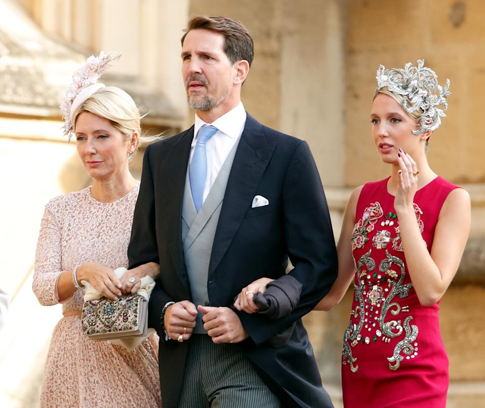 WINDSOR, UNITED KINGDOM - OCTOBER 12: (EMBARGOED FOR PUBLICATION IN UK NEWSPAPERS UNTIL 24 HOURS AFTER CREATE DATE AND TIME) Crown Princess Marie-Chantal of Greece, Crown Prince Pavlos of Greece and Princess Maria-Olympia of Greece attend the wedding of Princess Eugenie of York and Jack Brooksbank at St George's Chapel on October 12, 2018 in Windsor, England. (Photo by Max Mumby/Indigo/Getty Images)