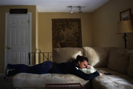 Fifteen year-old Sarah Steenhuysen rests at her home in Rehobeth, Massachusetts October 25, 2013 before going to watch her high school teammates play soccer. REUTERS/Brian Snyder