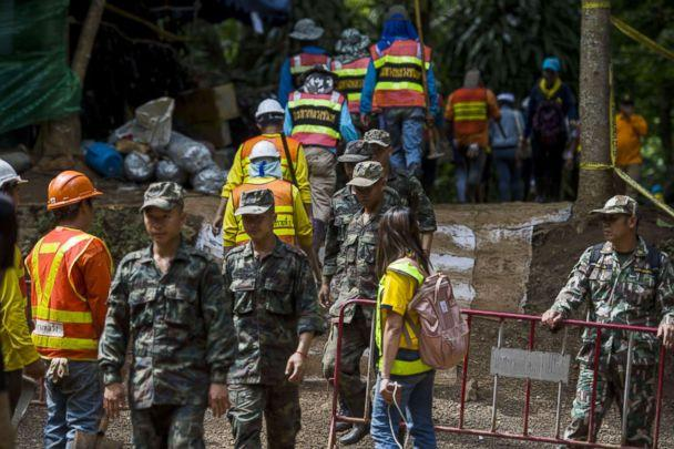 PHOTO: Thai soldiers and volunteers are seen at the entrance of Tham Luang cave at the Khun Nam Nang Non Forest Park in Mae Sai district of Chiang Rai province, July 5, 2018. (Thuye Aung/AFP/Getty Images)