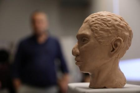 The artistic rendering of the head and face of a 13-year-old girl from the the prehistoric human species, Denisovan, based on technology developed by Hebrew University professor Liran Carmel and his team, is revealed at a news conference in Jerusalem