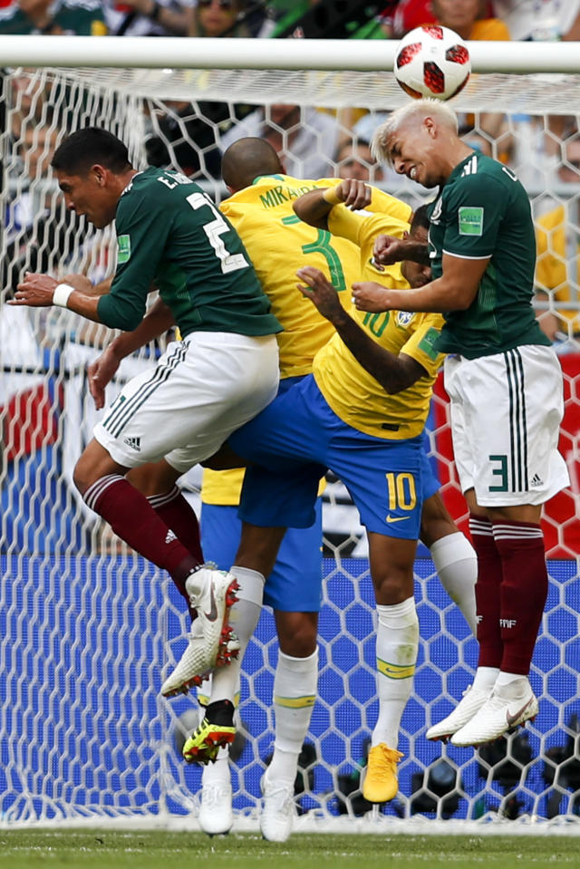 <p>Mexico's Carlos Salcedo heads the ball during the round of 16 match between Brazil and Mexico at the 2018 soccer World Cup in the Samara Arena, in Samara, Russia, Monday, July 2, 2018. (AP Photo/Eduardo Verdugo) </p>