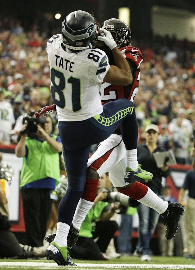 Seattle Seahawks wide receiver Golden Tate (81) catches a ball as Atlanta Falcons cornerback Asante Samuel (22) defends during the first half of an NFL football game, Sunday, Nov. 10, 2013, in Atlanta. Tate landed out of bounds on the catch. (AP Photo/David Goldman)
