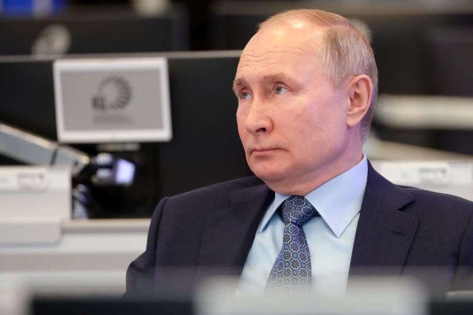 Russian President Vladimir Putin visits the Coordination Center of the Russian Government in Moscow, Russia, Tuesday, April 13, 2021. The centre was set up as a line of communication with the whole of Russia for analysing and collecting information, promptly using big data and solving arising problems. (Mikhail Metzel, Sputnik, Kremlin Pool Photo via AP)