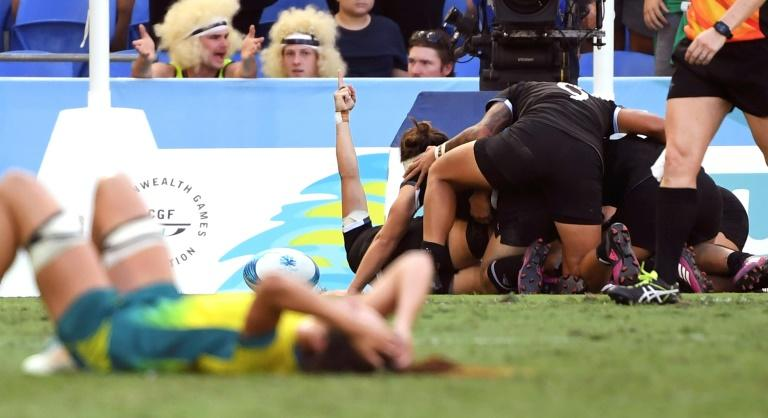 New Zealand celebrate after defeating Australia in the women's rugby sevens gold medal match thanks to a sudden-death try from Kelly Brazier