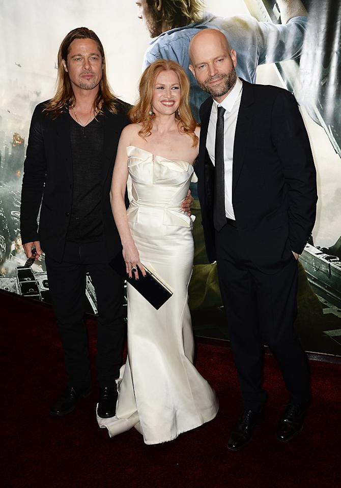 LONDON, ENGLAND - JUNE 02:  (L-R) Brad Pitt, Mireille Enos and Mark Forster attend world premiere of World War Z at the Empire Leicester Square on June 2, 2013 in London, England.  (Photo by Dave J Hogan/Getty Images)