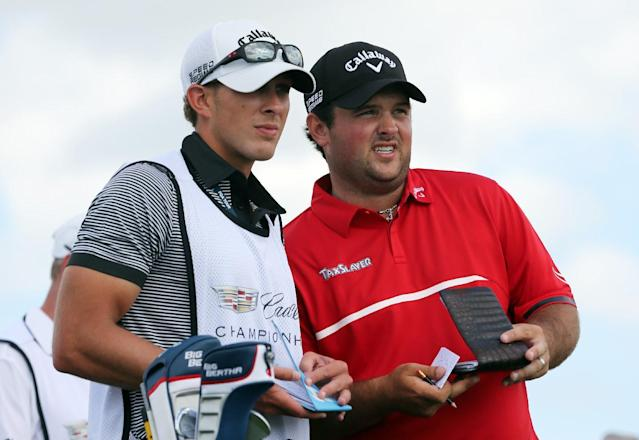 Patrick Reed, right, and his caddie Kessler Karain talk on the third tee during the final round of the Cadillac Championship golf tournament on Sunday, March 9, 2014, in Doral, Fla. (AP Photo/Wilfredo Lee)