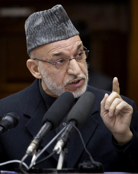 Afghan President Hamid Karzai gestures as he addresses the Afghan Parliament in Kabul, Afghanistan, Wednesday, March 6, 2013. Karzai called on his security forces to end incidents of torture and abuse of the Afghan people and said that Afghan forces are violating their own people's rights, making it harder for him to raise the issue when abuses are carried out by foreigners. (AP Photo/Anja Niedringhaus)