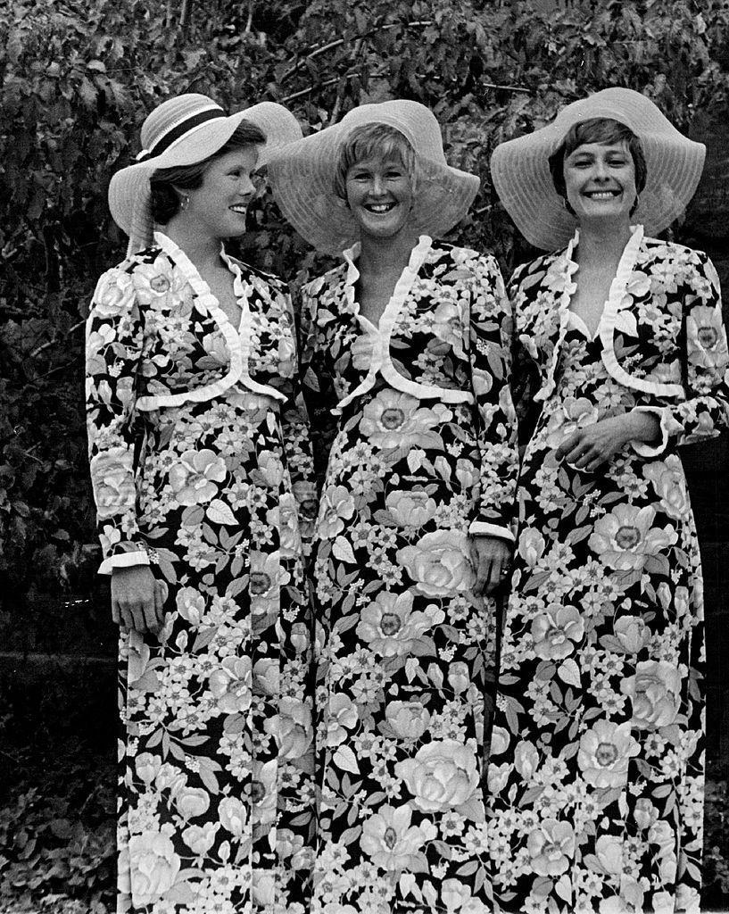 <p>The '70s were a bold decade, which is why some bridesmaids walked down the aisle in head-to-t0e floral dresses with matching bolero jackets. </p>