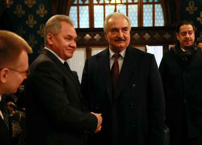 Commander of the Libyan National Army Khalifa Haftar shakes hands with Russian Defence Minister Sergei Shoigu before talks in Moscow