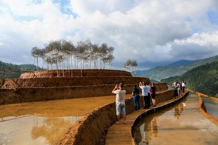 """A """"crystal cloud"""" installation of 58,000 shimmering Swarovski beads in the rice-terraced hills of northern Vietnam opened earlier this year (AFP Photo/Anh TUAN)"""